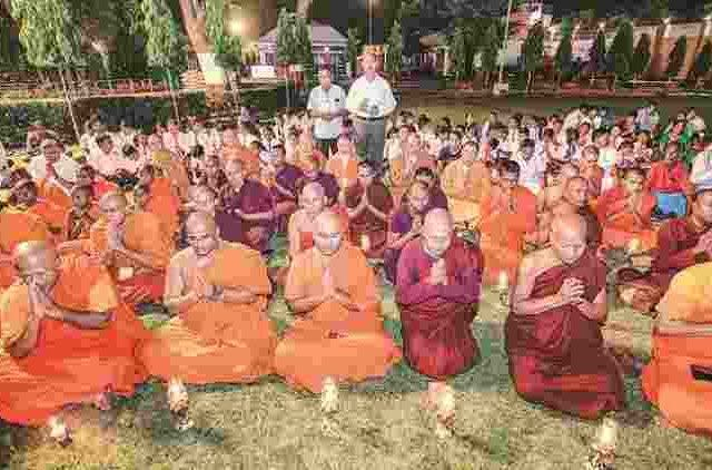 Buddhist-Monks-Pray-More-News-DKODING