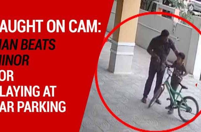 Caught-on-cam-Man-beats-minor-for-playing-at-car-parking-Videos-DKODING