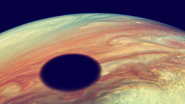 Shadow of Jupier's moon Io falls on the surface of Jupiter the Gas Giant NewsShot DKODING