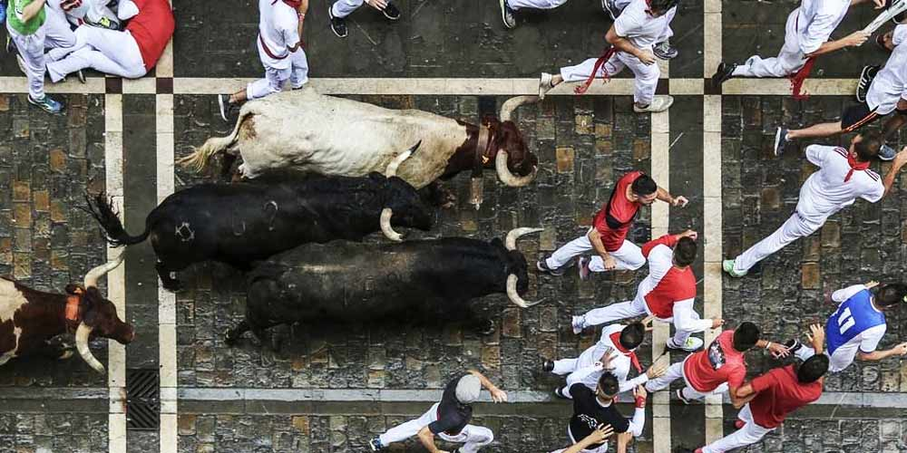 La-Tomatina-Running-of-the-Bulls-2019-Effects-Spitting-Ketchup-face-of-humanity-NEWSLINE-DKODING