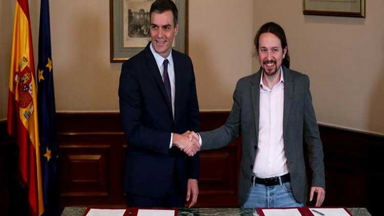 Spain's ruling Socialists sign coalition deal with Podemos